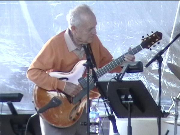 Duquesne faculty member and Pittsburgh icon Joe Negri dazzled the crowd with his guitar.